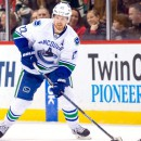 Canucks admit they don't play aggressively in OT