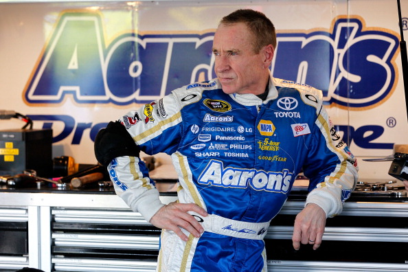 KANSAS CITY, KS - APRIL 20:  Mark Martin, driver of the #55 Aaron's Dream Machine Toyota, looks on in the garage during practice for the NASACAR Sprint Cup Series 400 at Kansas Speedway on April 20, 2012 in Kansas City, Kansas.  (Photo by Tyler Barrick/Getty Images)