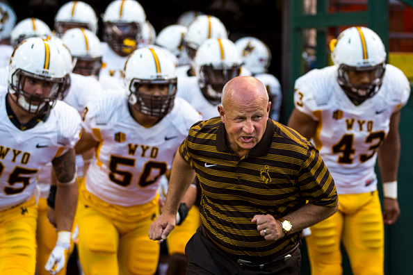 HONOLULU, HI - OCTOBER 11: Craig Bohl head coach of the Wyoming Cowboys and the team take to the field before the first quarter of a college football game between the Wyoming Cowboys and the Hawaii Warriors at Hawaiian Airlines Field at Aloha Stadium on October 11, 2014 in Honolulu, Hawaii. (Photo by Kent Nishimura/Getty Images)