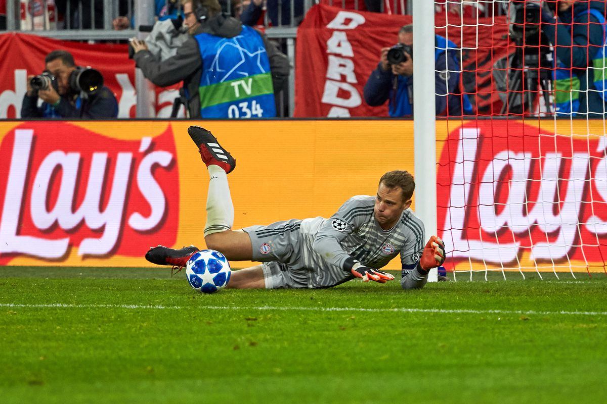 FC Bayern Muenchen v Ajax - UEFA Champions League Group E DORTMUND, GERMANY - OCTOBER 03: Goalkeeper Manuel Neuer of Bayern Muenchen controls the ball during the Group A match of the UEFA Champions League between Borussia Dortmund and AS Monaco at Signal Iduna Park on October 3, 2018 in Dortmund, Germany.